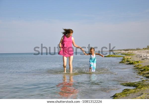 Mother Daughter Run Across Seaside Happy Stock Photo (Edit