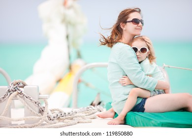 Mother and daughter sailing on a luxury yacht