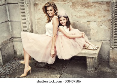 Mother and daughter in same outfits wearing tutu skirts