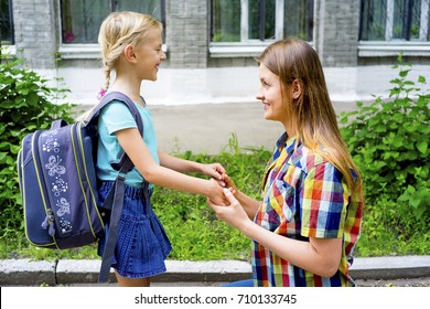 Mother and daughter at school