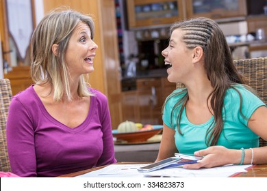 mother and daughter sharing a moment of complicity and laughing