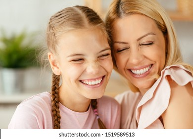 Mother and daughter sharing a moment at home