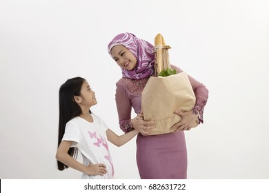 mother and daughter shopping for grocery