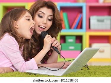 mother and daughter singing karaoke