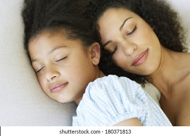 Mother and daughter sleeping