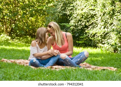 Mother and daughter spend a weekend in nature. holiday in nature. mother and daughter having fun on the lawn