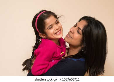 Mother and daughter spending a few happy minutes together at home.