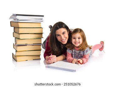 Mother and daughter studying together
