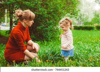 mother and daughter in summer Park on the grass