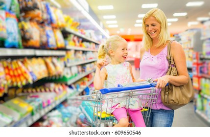 Mother And Daughter At The Supermarket