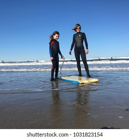 Mother and daughter surfing