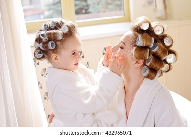 mother and daughter are taking bath