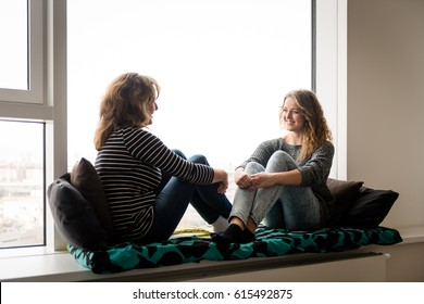 Mother and daughter talking. Spending time together.