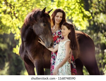 mother and daughter with their horse