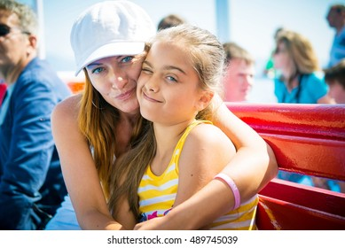 Mother and daughter together, mother and daughter hugging in a public place. summer trip on ship. Attractive Mother and daughter spending time together