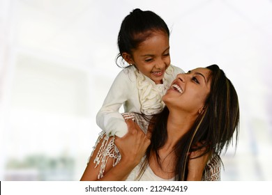 Mother and daughter together inside of their home