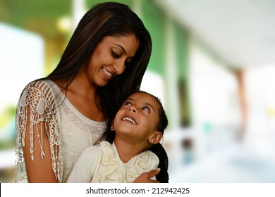 Mother and daughter together outside of their home