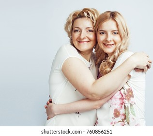 mother with daughter together posing happy smiling isolated on white background with copyspace, lifestyle people concept