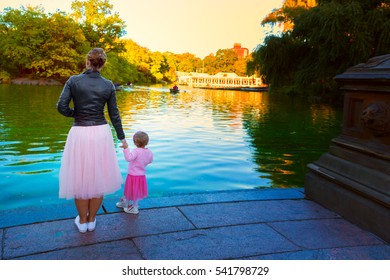 Mother and Daughter in TooToo skirts overlooking a lake in central park