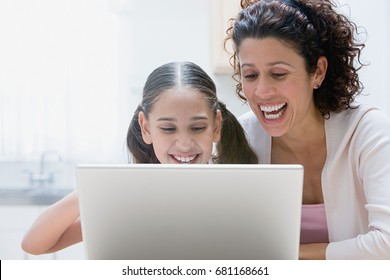Mother and daughter using a laptop computer