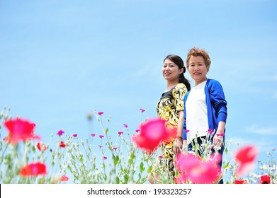 Mother and daughter walk down the street on the floral