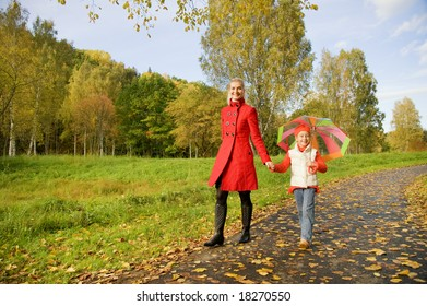 Mother and daughter walking outdoors