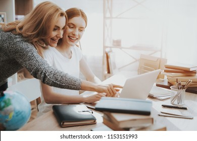 Mother and Daughter Watching into Laptop at Home. Daughter Doing Homework. Mother and Daughter at Home. Teenage Girl. Education at Home Concept. Women Using Digital Device. Studying Girl.