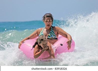 mother and daughter in the waves