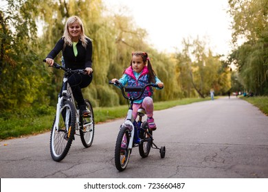 Mother and daughter were cycling at the park