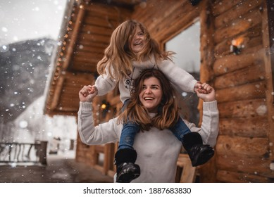 Mother and daughter in winter chalet