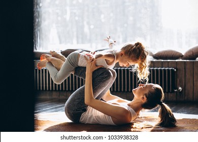 Mother and daughter yoga at home