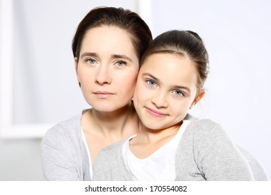 Mother and daughter / Young mom with beautiful daughter isolated on white background