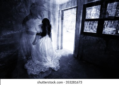 Mother and Daughter,Ghost in Haunted House,Mysterious Woman in White Dress Standing in Abandon Building,Horror Background For Halloween Concept and Book Cover Ideas