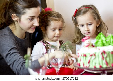 Mother, daughters and cake