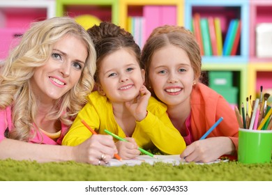 Mother with daughters drawing