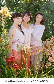 mother with daughters in garden
