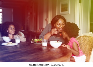 Mother and daughters having a meal together