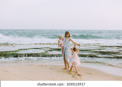 Mother with daughters on the beach