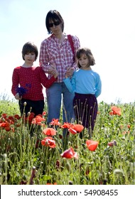 mother and daughters on the meadow