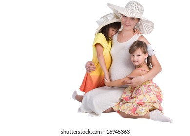 mother and daughters on the white