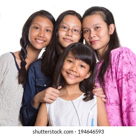 Mother and daughters over white background