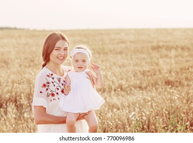 mother and daugther in field