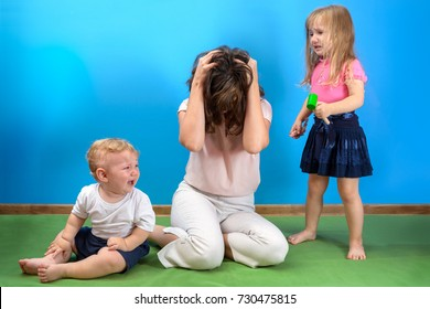 mother is depressed by screaming children. problems of motherhood.