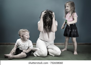 mother is depressed by screaming children. problems of motherhood.  black and white