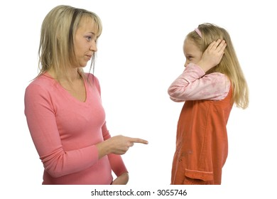 Mother is disciplining her 5-6yo daughter. Girl's stopping her ears. Side view. Isolated on white in studio.