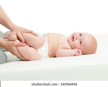 mother doing gymnastics her baby infant