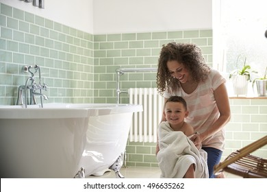 Mother Drying Son With Towel After Bath
