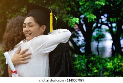 Mother embraces daughter with joy on graduation day,Young happy graduate hugging her mother at graduation ceremony,Family,Graduation,Proudly,Degree certificate,Congratulation ceremony and successful,