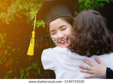 f131c558edb Mother Embraces Daughter Joy On Graduation Stock Photo (Edit Now ...