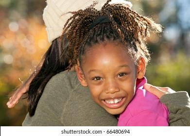 Mother Embracing Daughter